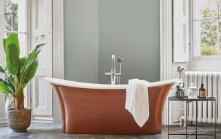 Many plants thrive on humidity, so placing them in a bathroom is a great idea. Ionian bath in copper, £5,082; Sherwood porcelain replica-wood flooring in Rowan, £71.88 per 80x80 cm panel; both Fired Earth: 01295 812 088; firedearth.com.